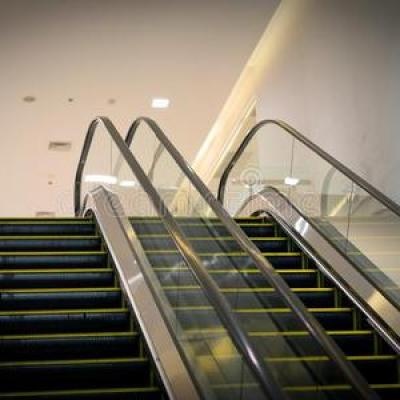 What is the difference between an escalator and a moving sidewalk?